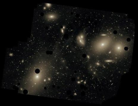 L'ammasso della Vergine, dove si vedono bene gli aloni che circondano le galassie ellittiche
