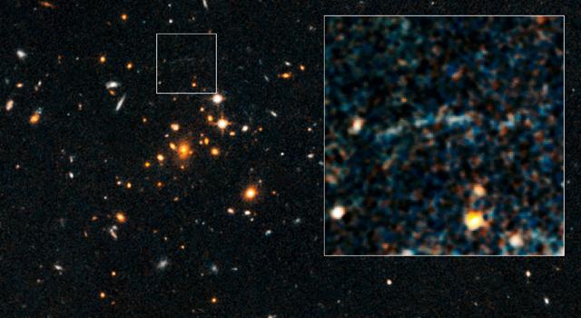 l'arco gravitazionale di una galassia estremamente lontana