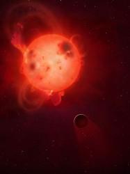 Una rappresentazione artistica del pianeta Kepler-438b e della sua violenta stella madre. Il pianeta è spesso investito da violenti brillamenti ed espulsioni di massa coronale che potrebbero renderlo inabitabile, anche strappandogli via la sua atmosfera. Crediti: Mark A Garlick / University of Warwick