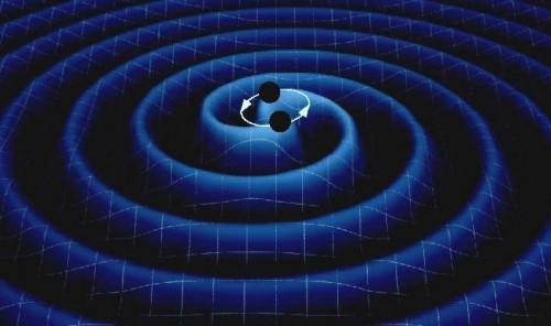 Rappresentazione artistica di un sistema di due corpi massicci (stelle di neutroni o buchi neri) in rotazione che perdono energia a causa dell'emissione di onde gravitazionali.