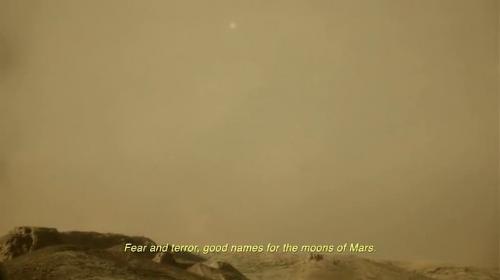 Phobos visto al tramonto dalla superficie di Marte