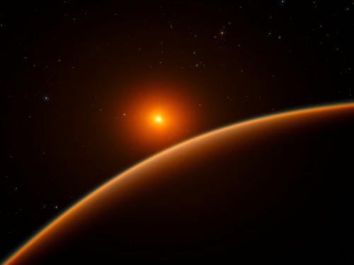 """Questa immagine artistica mostra l'esopianeta LHS 1140b, che orbita attorno ad una nana rossa distante da noi 40 anni luce, e che è candidato al titolo di """"miglior pianeta in cui cercare segni di forme di vita fuori dal sistema solare"""" ."""