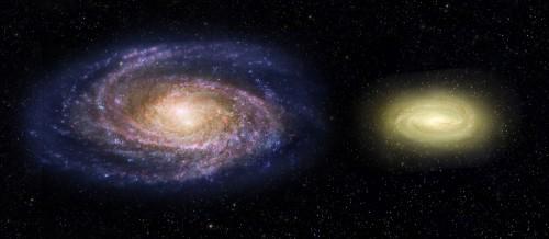 Questa rappresentazione artistica mostra come apparirebbe la galassia MACS2129-1 (a destra) in confronto alla nostra, la Via Lattea (a sinistra). Anche se dotata di una massa tripla, MACS2129-1 ha una dimensione pari a circa la metà e le sue stelle ruotano al doppio della velocità di quele nella Via Lattea. Le regioni di color blu nella nostra Galassia indicano la presenza di stelle in formazione mentre MACS2129-1 è di colore giallo, a testimonianza di popolazioni stellari di età più avanzata e dell'assenza di giovani astri. Crediti: NASA, ESA, and Z. Levy (STScI)